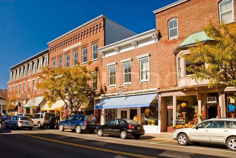 Typical New England or Midwest downtown main street. This street scene could be any small town U.S.A. Old brick buildings turned into small businesses, shops and cafe\'s, stock photo