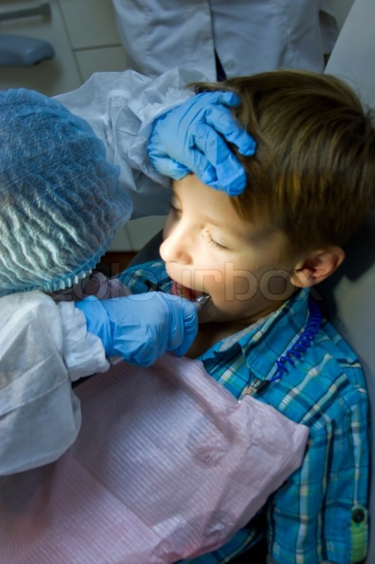 Couple of kids playing doctor at the dentist | Stock Photo ...