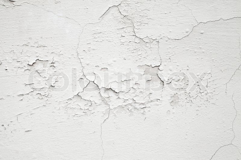 Closeup white concrete wall texture with cracked plaster ...