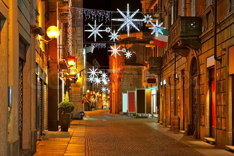 Old city central street with illuminations and decorations