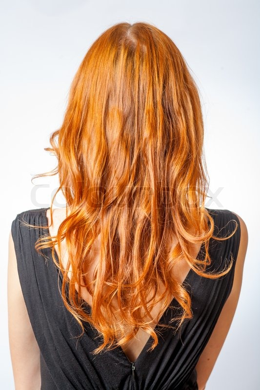 Vertical shot of Back view of Red curly long hair of ...
