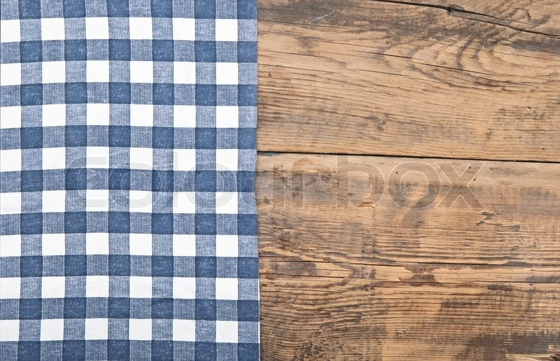 Tablecloth textile texture on wooden table background ...