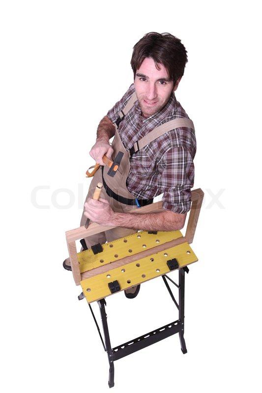 mann mit hammer und mei el stockfoto colourbox. Black Bedroom Furniture Sets. Home Design Ideas