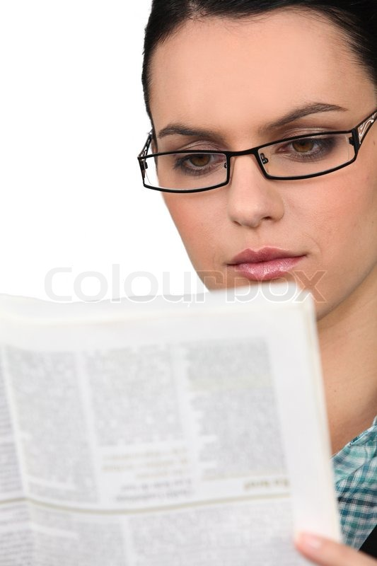 young woman in glasses reading a newspaper stock photo colourbox