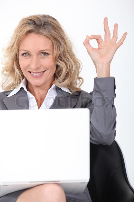 Blonde Businesswoman With A Laptop Stock Image