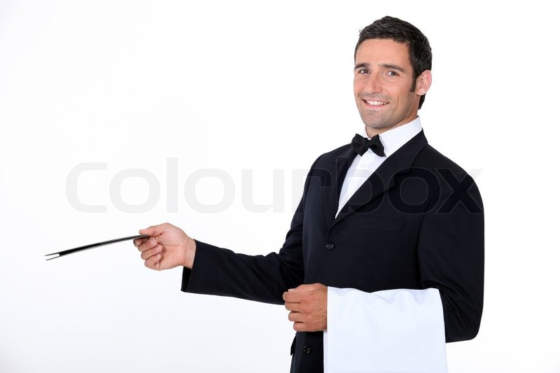 a waiter of a fancy restaurant stock photo colourbox