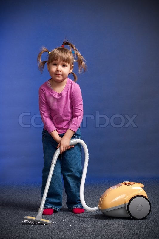 little girl with vacuum cleaner