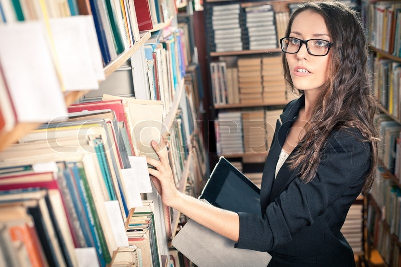 brunette woman at library stock photo colourbox