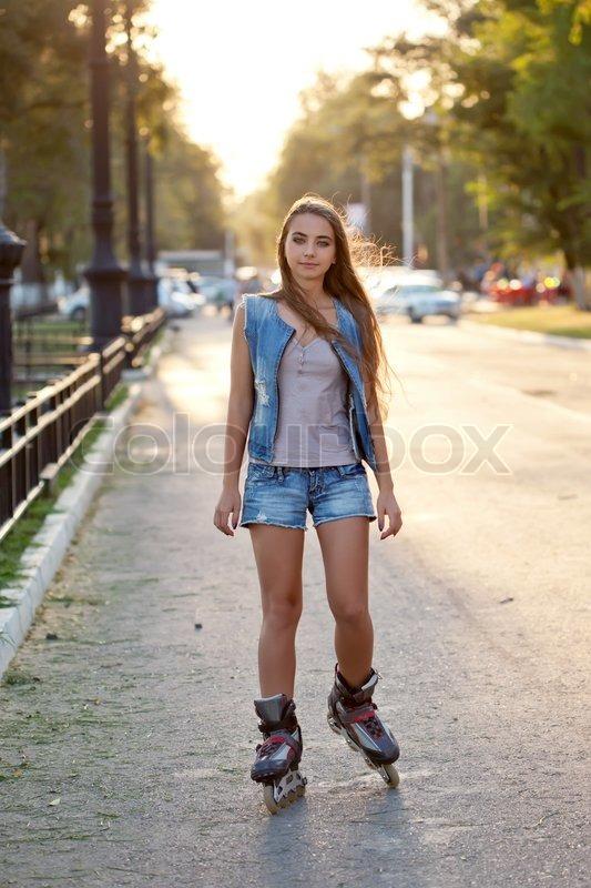 Teenager girl skating during sunset   Stock Photo   Colourbox