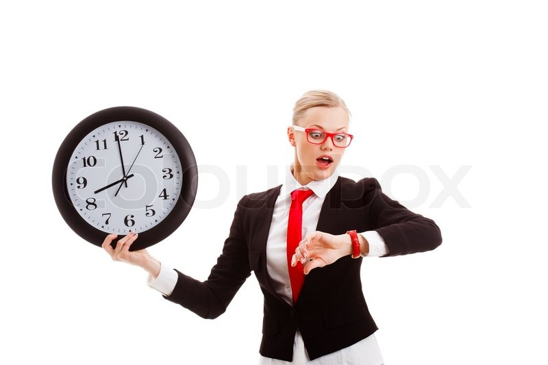 woman holding clock and looking to watch stock photo colourbox