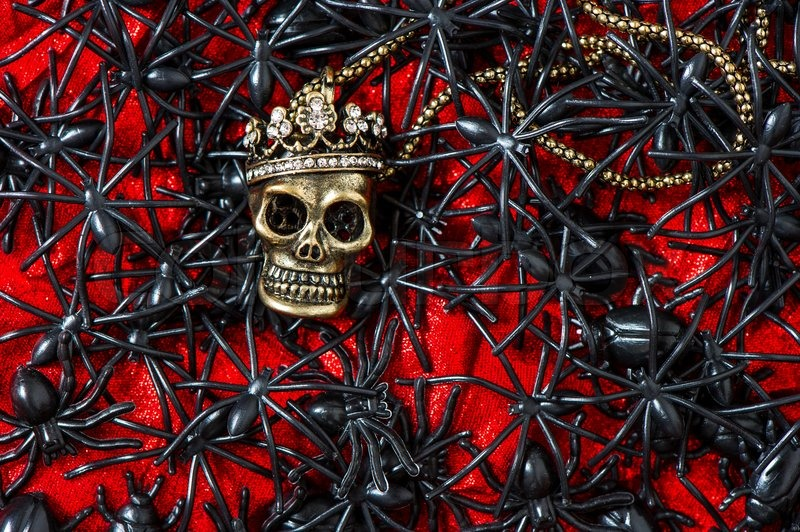 skull with black spider on bloody red