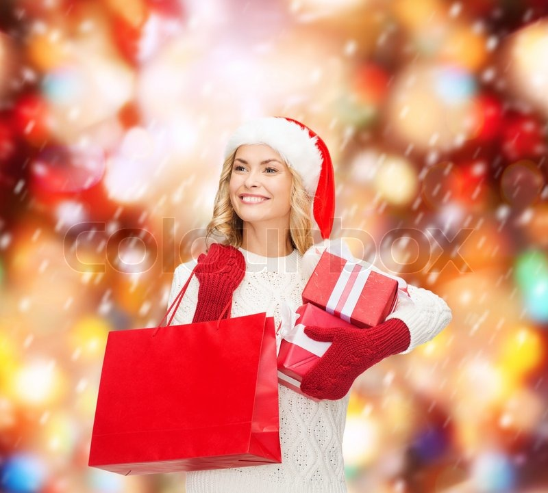 Woman In Santa Helper Hat With Shopping Bags Stock Photo