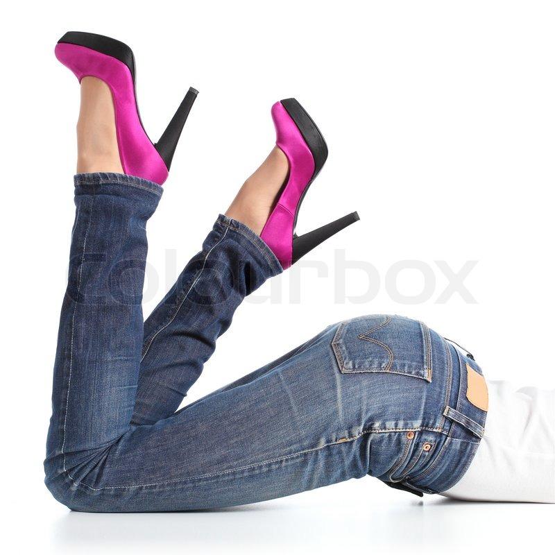 Smuk kvinde ben med jeans og fuchsia | Stock foto