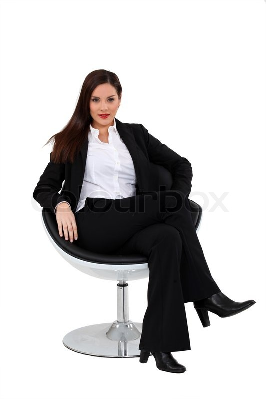 Brunette Sat On Swivel Chair Stock Photo Colourbox