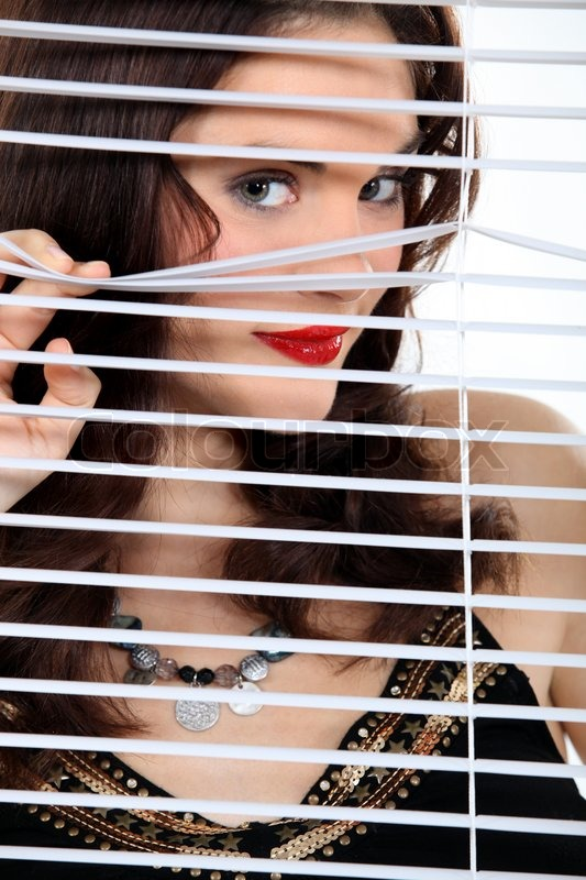 Attractive Woman Peeking Through Some Stock Photo