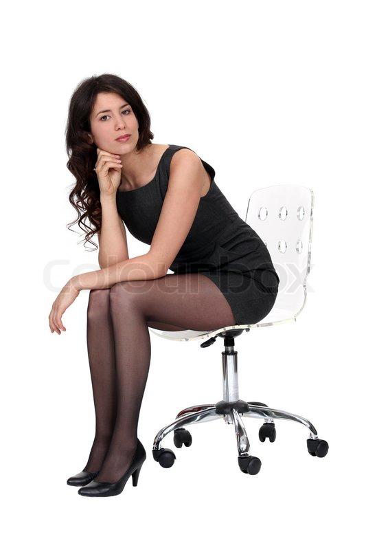 Sexy Frau Sitzt Auf Einem Stuhl Stockfoto Colourbox
