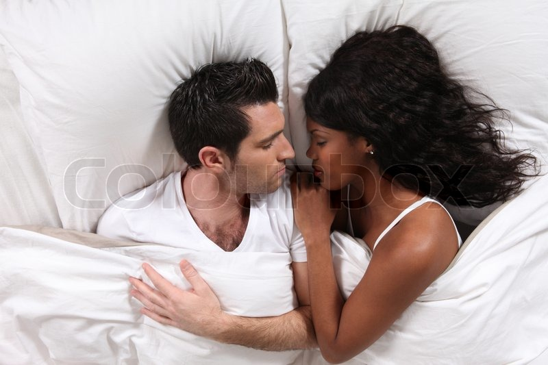 Husband And Wife Sleeping In Their Bed Stock Photo