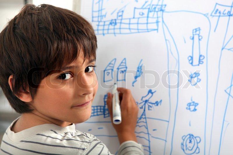 Child drawing a street scene, stock photo