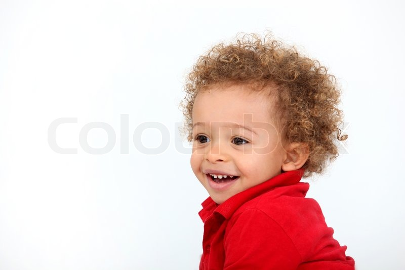 Baby with curly hair | Stock Photo | Colourbox