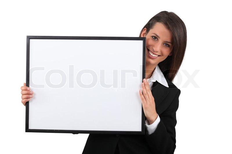 Woman holding a frame | Stock Photo | Colourbox