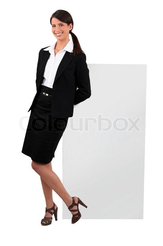 Cheeky kvinde i en nederdel jakkesæt | Stock foto | Colourbox