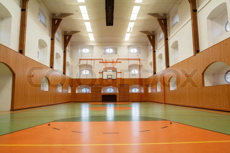 empty interior of public gym with basketball court stock photo colourbox