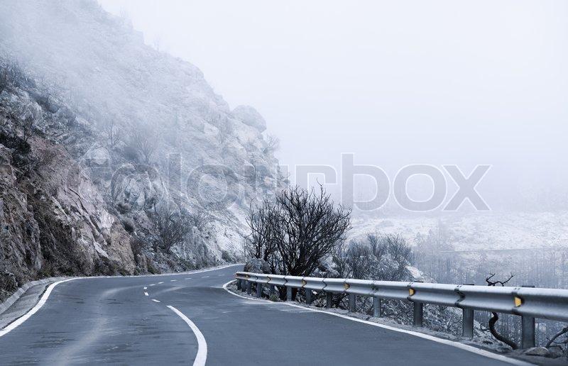 Winter Foggy Winding Road in Tenerife , stock photo