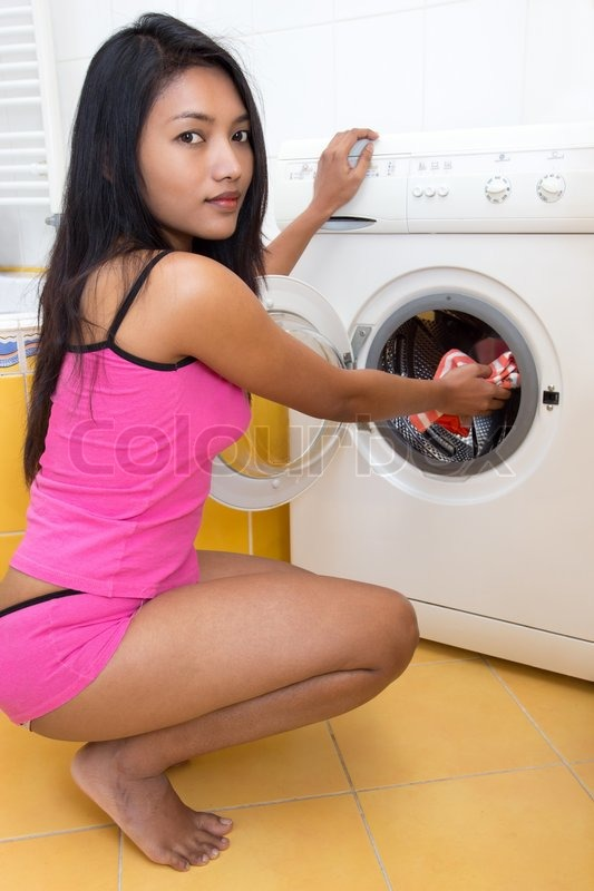 Young Woman Doing Laundry Stock Photo Colourbox