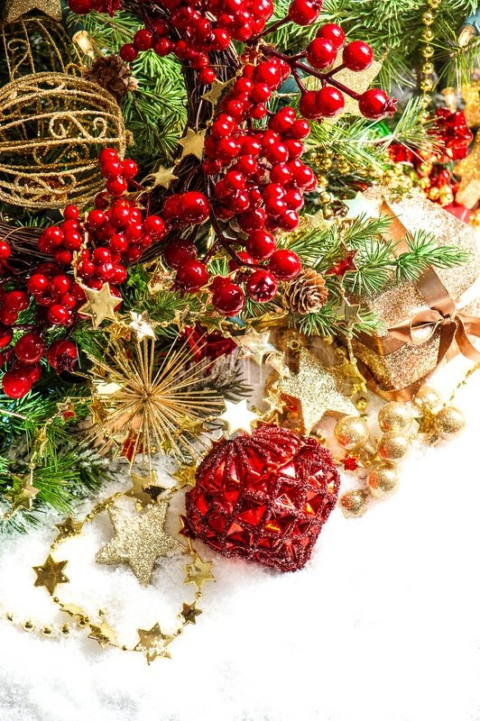 Baubles, golden garlands, christmas tree and red berries | Stock ...