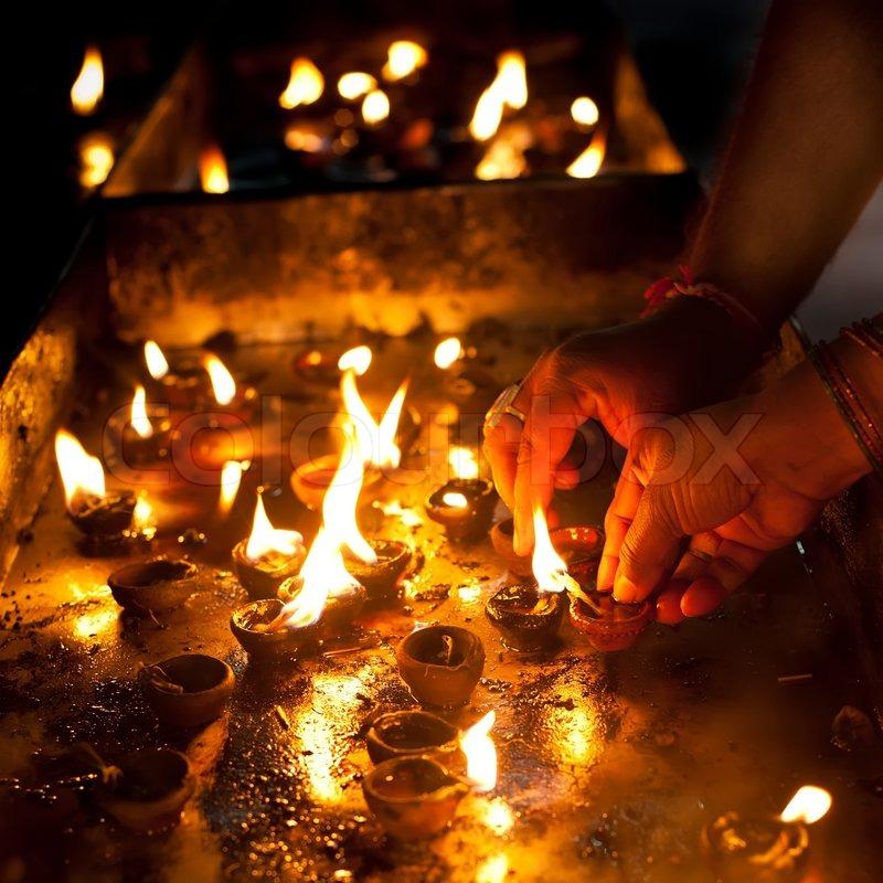 People Burning Oil Lamps As Religious Ritual In Hindu