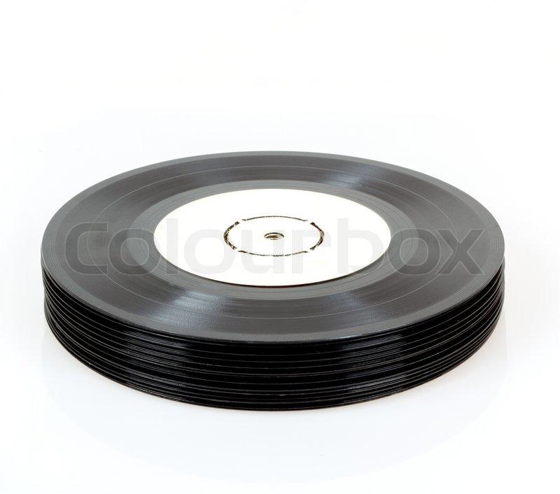 stack of black vinyl records on white background stock photo