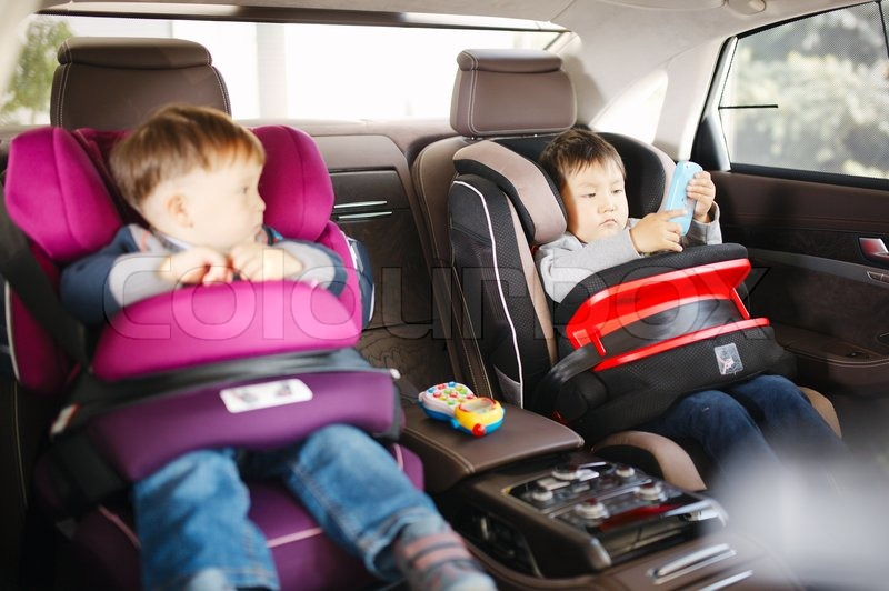 Luxury Baby Car Seat For Safety With Happy Kids Stock Photo