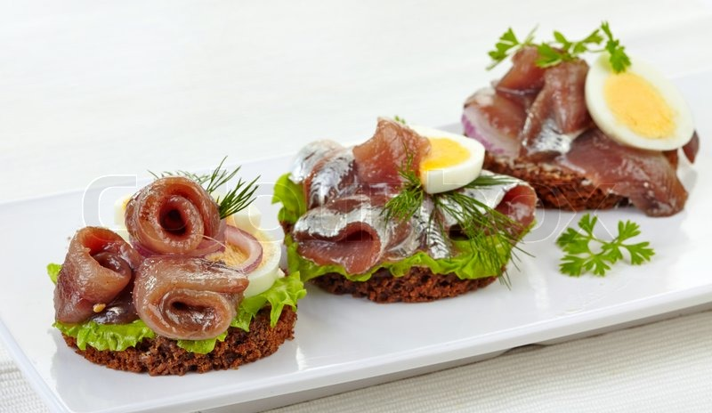 Canapes with anchovies and egg stock photo colourbox for Canape suppliers