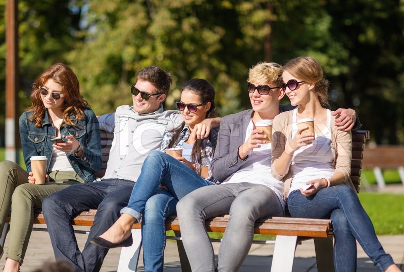 Group of students or teenagers hanging out stock photo for Hanging groups of pictures