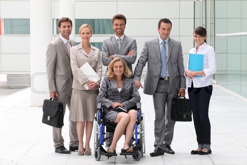 Business people stood outside building, stock photo