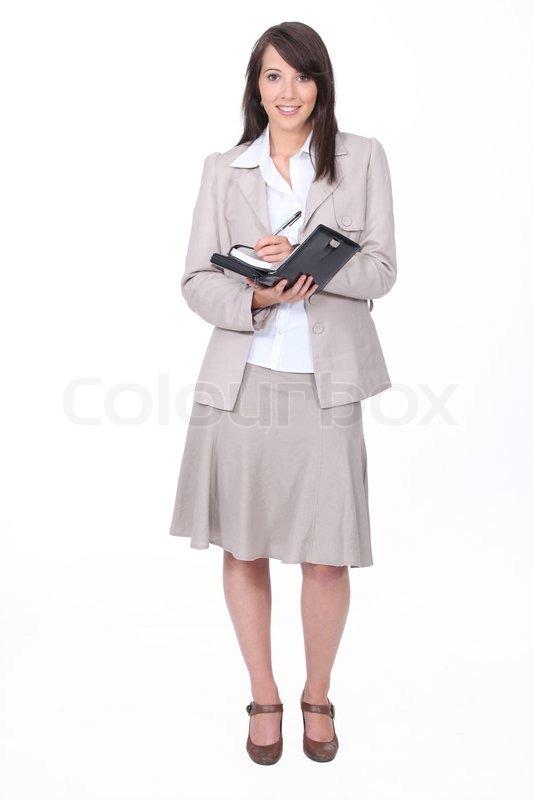 Ung kvinde i en nederdel jakkesæt | Stock foto | Colourbox