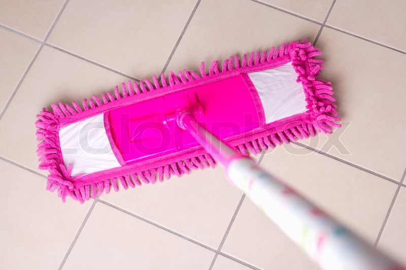 Pink Mop Cleaning Light Tile Floor In Stock Photo