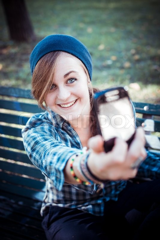 Beautiful Young Blonde Hipster Stylish Woman Selfie In The