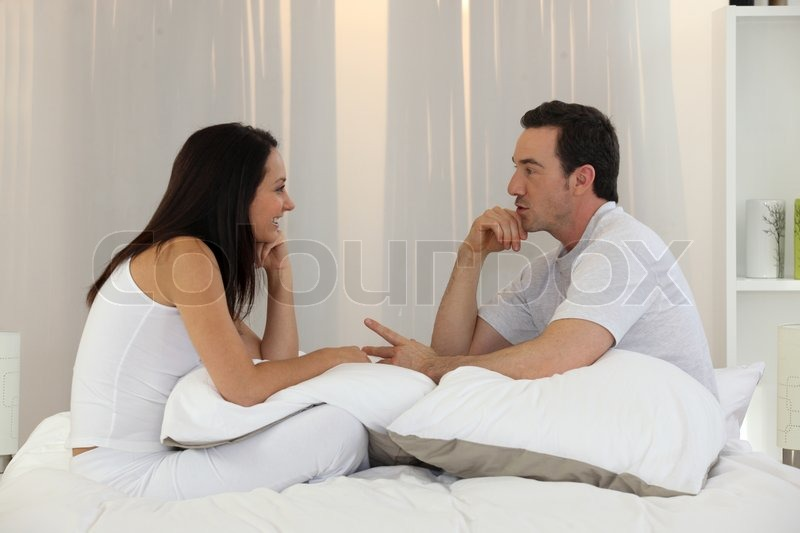Married couple having an intimate discussion, stock photo