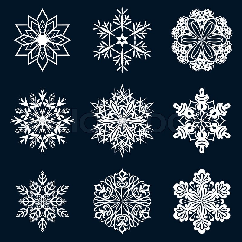 White snowflake ornate shapes isolated on dark blue ...