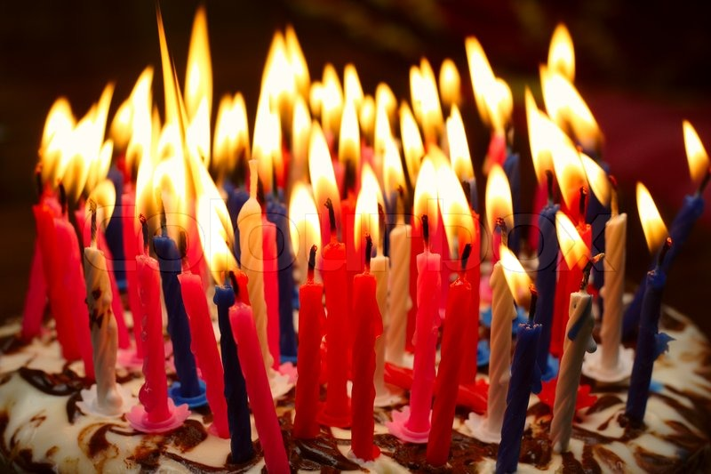 Birthday Cake With The Lot Of Burning Candles Stock Photo Colourbox