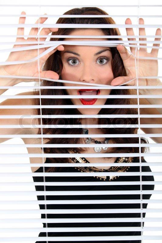Woman Peeking Through Blinds Stock Colourbox