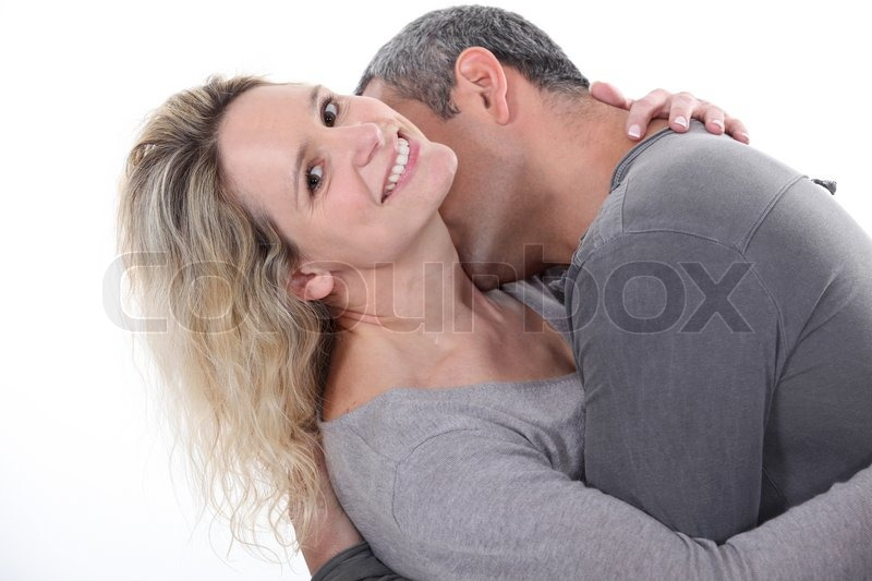 Man Kissing Wife S Neck Stock Photo