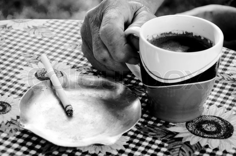 Old Female Hand Holding Cup Of The Dark Coffee Stock