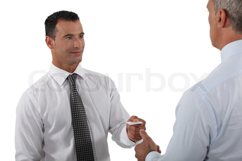 Man handing over his business card to a potential client stock man handing over his business card to a potential client stock photo colourbox colourmoves