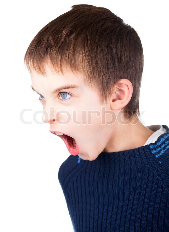 angry boy wearing blue sweater shouting on white background stock