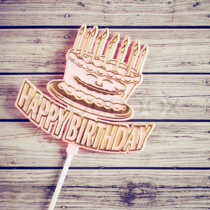 "Buy Stock Photo ""Happy birthday on wooden background with retro filter ..."