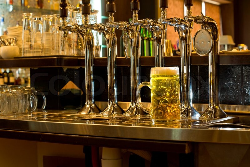 Row Of Stainless Steel Beer Taps On A Wooden Counter For