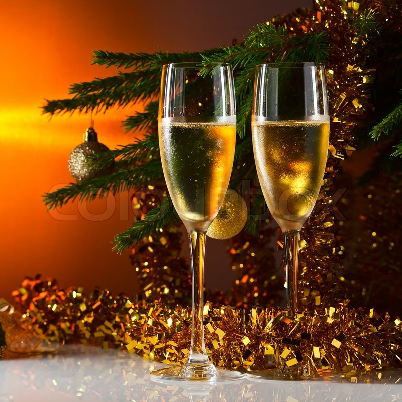 two glasses with champagne and christmas tree stock photo colourbox