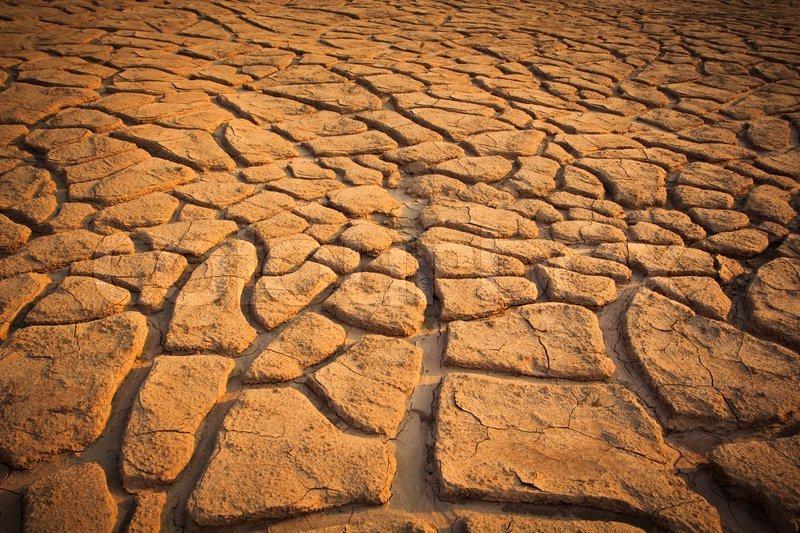 Cracked Soil Ground Background Textured Stock Photo